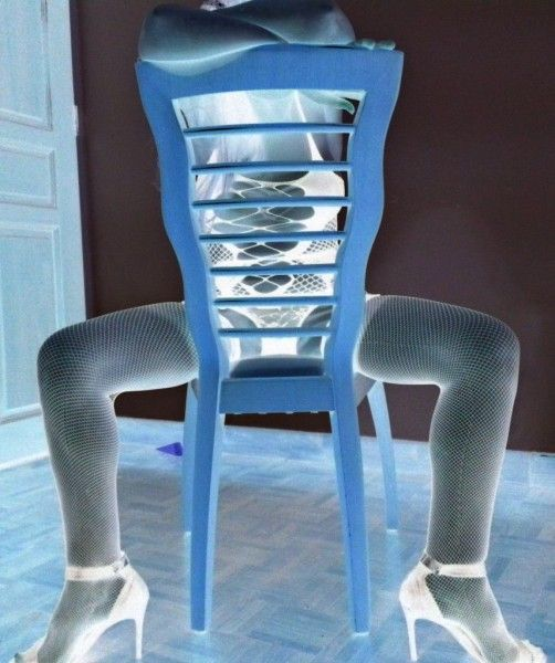 cross legged on chair